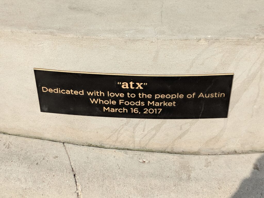 Dedication plaque for ATX sign erected in 2017 at West 5th & North Lamar by the original Whole Foods Market located in Austin